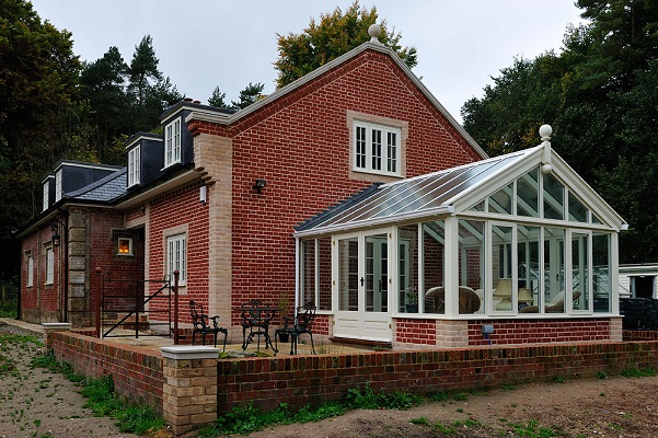 Hardwood spray finished Conservatory with outward opening doors