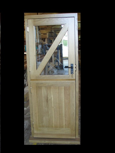 Oak stable door, glazed top halve with diagonal top brace