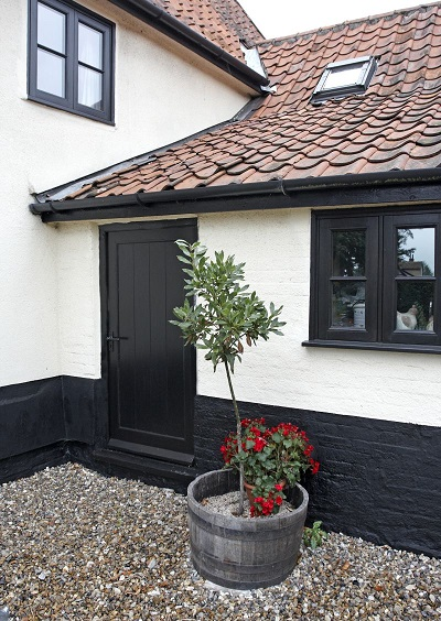 Black Horizontal bar windows and Black external framed T & G Type Wooden Door