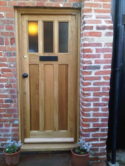 oak triple panel door with obscure glazing finished with oil