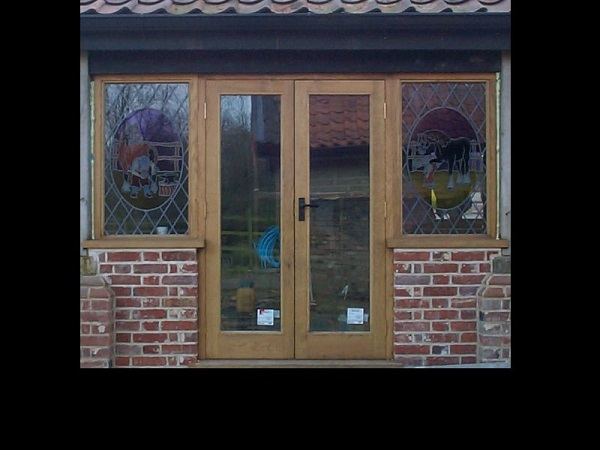Double oak hardwood doors with side lights