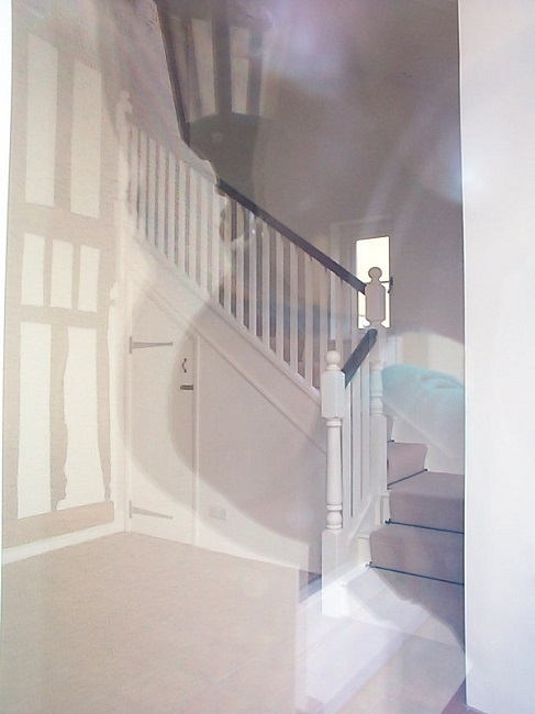 White painted stairs with turned newels and hardwood handrail