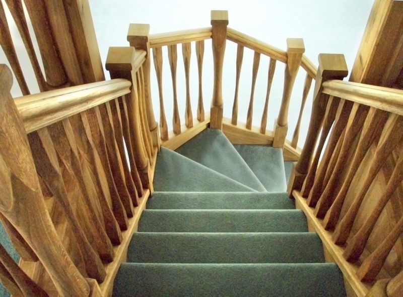 Oak staircase with slender style spindles and newels. Left wind.