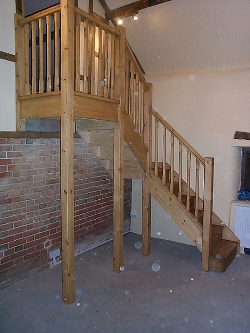 Oak double turn staircase with stop chamfered newels and spindles