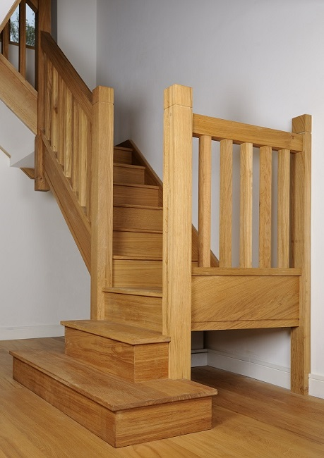 Oak staircase with square chunky newels, spindles and double square curtail