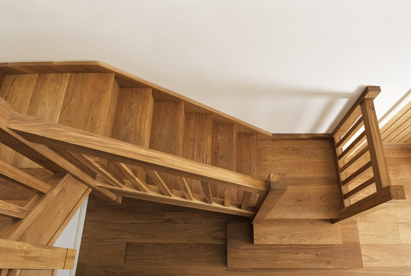 Oak staircase with square chunky newels, spindles and double square curtail.4