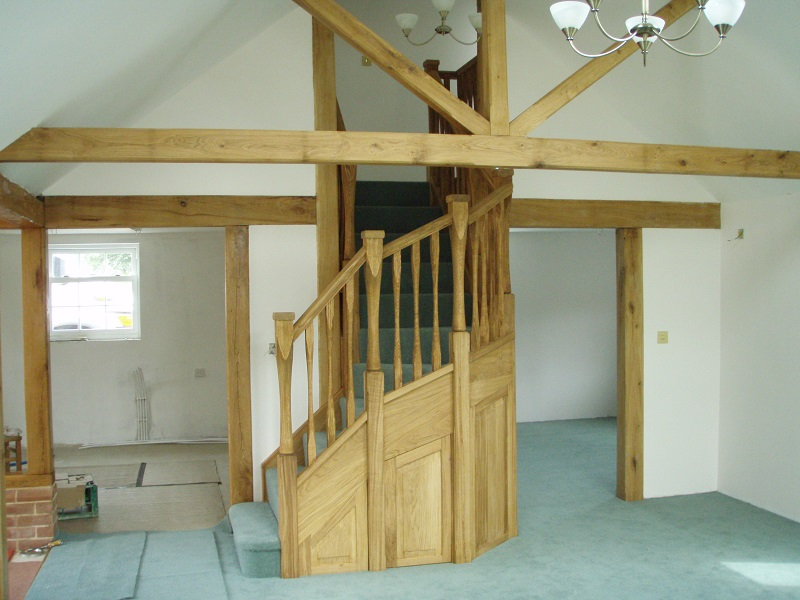 Oak staircase with slender style spindles and newels. Left wind. 4