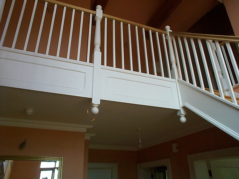 Victorian style staircase, painted white with hardwood handrail and ball newel caps