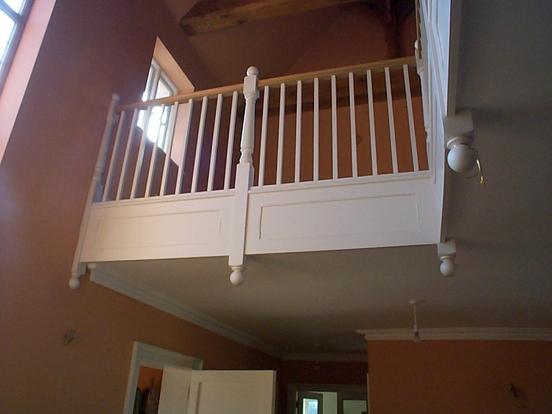 Victorian style landing, painted white with hardwood handrail and ball newel caps.