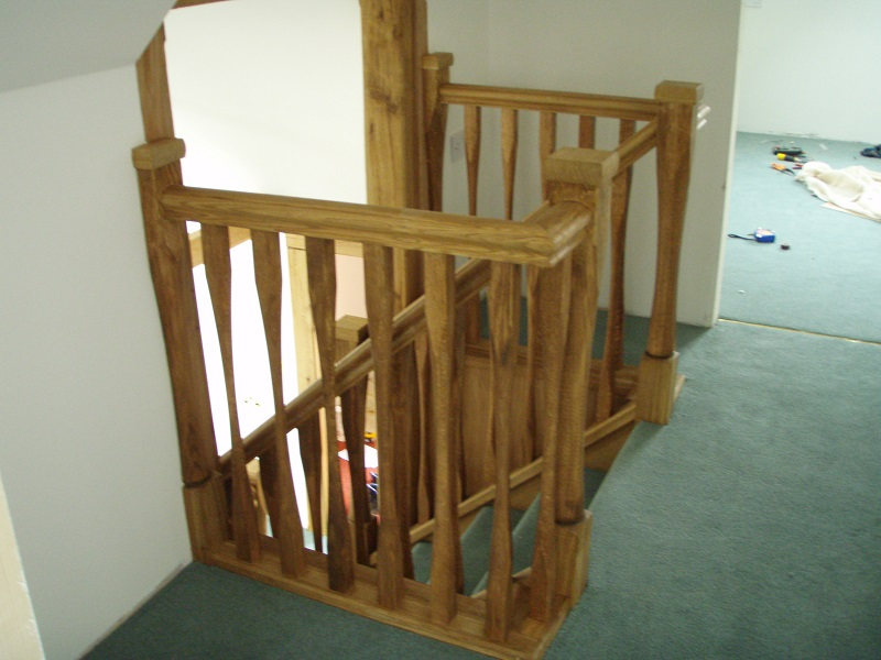 \Oak landing with slender style spindles and newels. Left wind