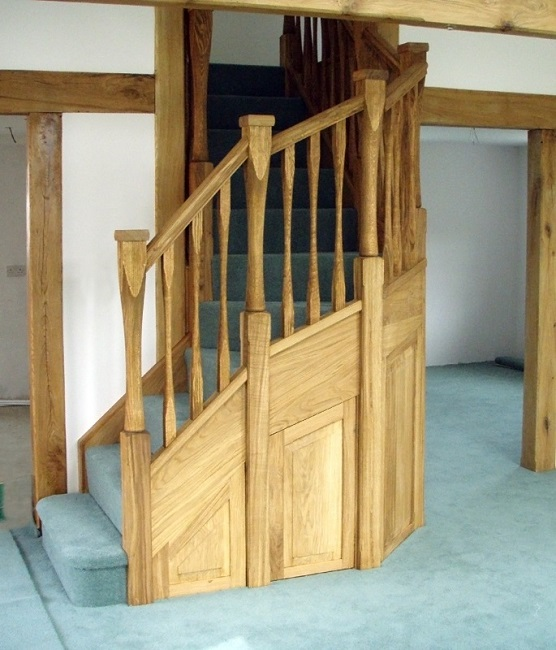 Oak staircase with slender style spindles and newels. Left wind. 2