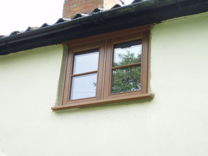 Double casement stained hardwood window