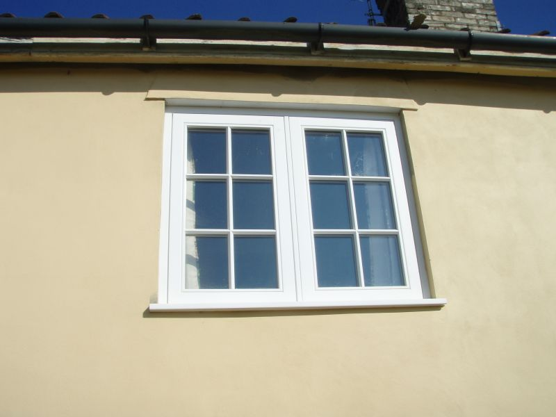 Double casement fully decorated white window