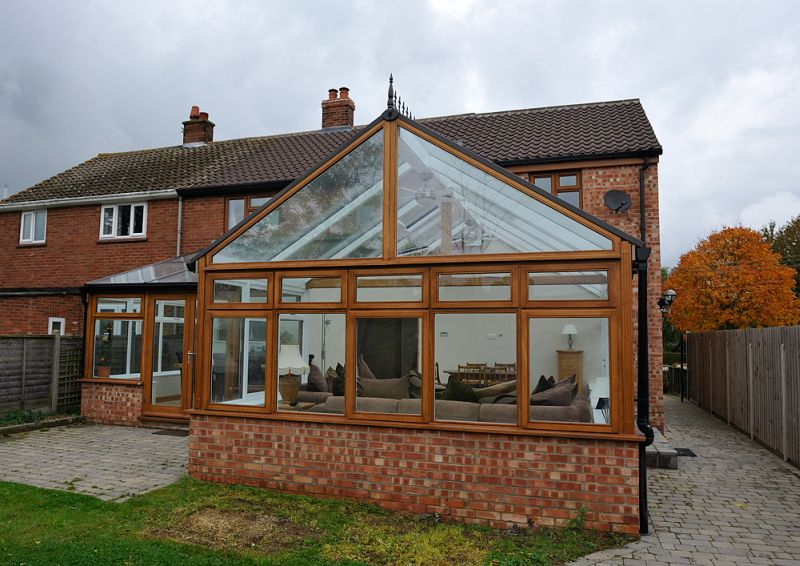 Stained hardwood Conservatory with automatic roof lights.