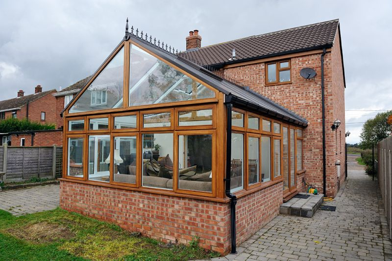 Hardwood Conservatory with double opening full glassed doors
