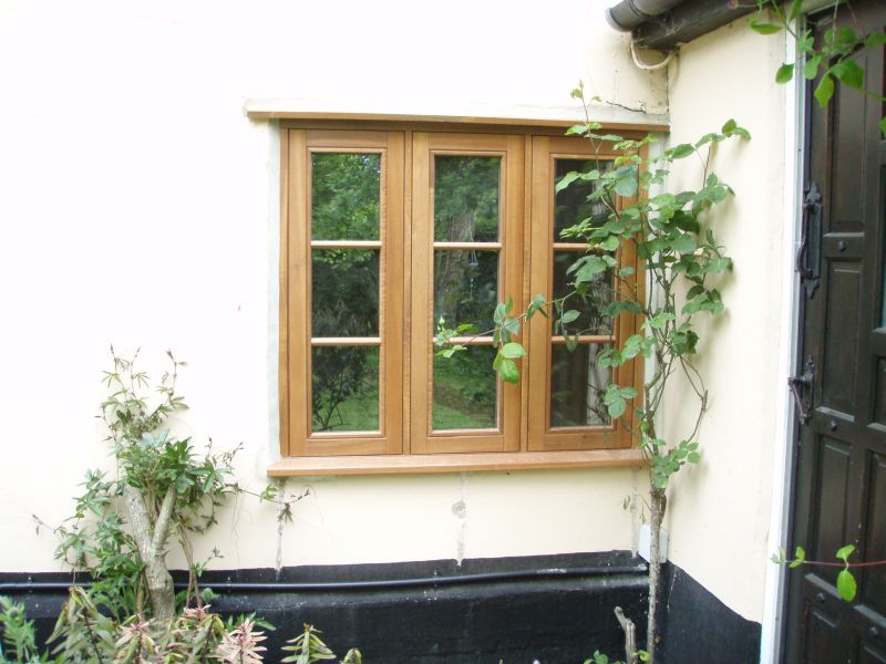 Triple casement stained timber window
