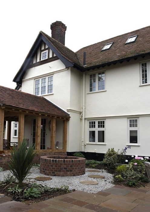 Tudor style house with flush casement windows