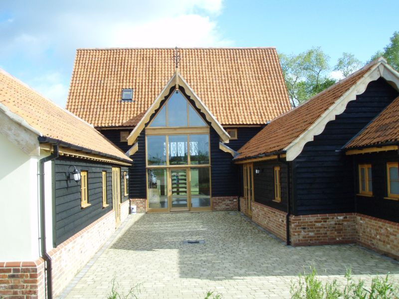 Barn Conversion Screen And Windows With Swept Heads